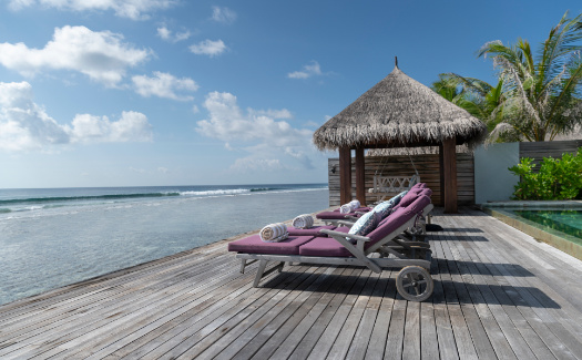 Private beach deck with sun loungers