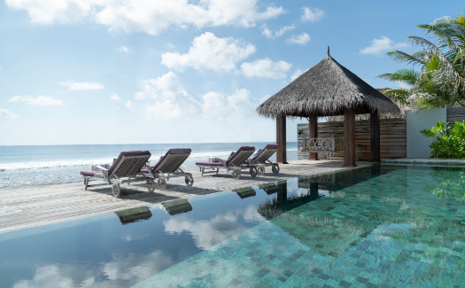 Infinity pool with sun loungers