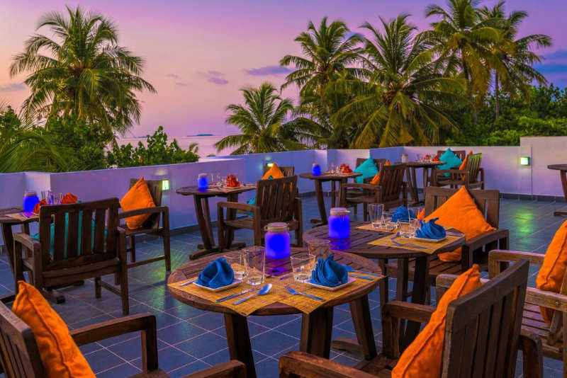 Boutique beach roof top restaurant at sunset