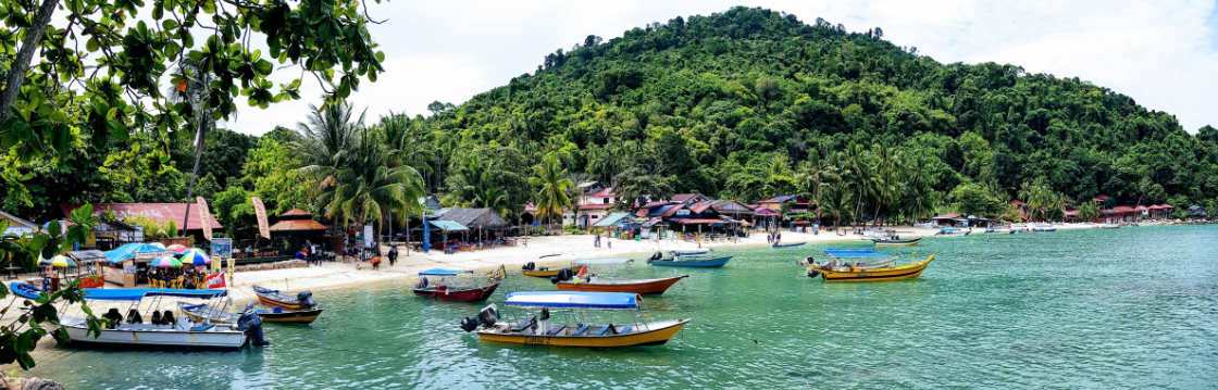 View of a beach with boats in Malaysia
